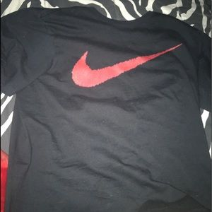 Black nike shirt with red check